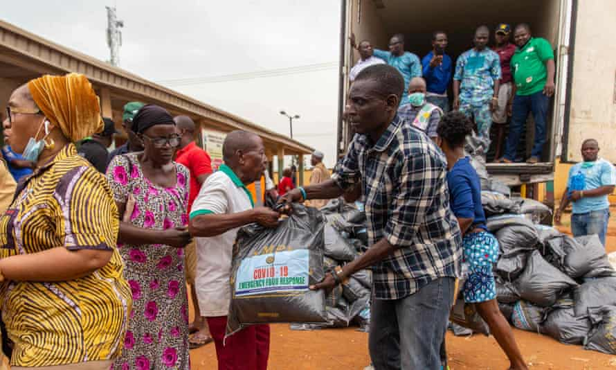 Lagos state officials hand out food relief bags as Nigeria tries to curb the spread of the coronavirus.
