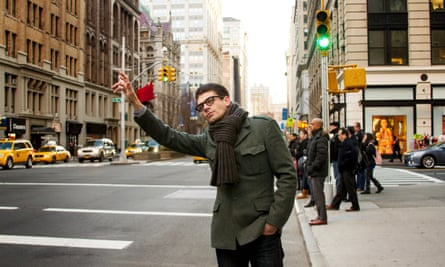Man hailing a taxi on a New York street