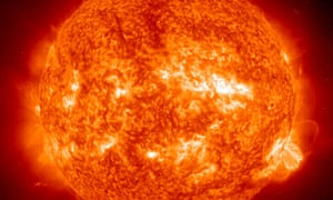 A solar flare, lower right, seen in 2001.