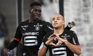 Rennes' midfielder Wahbi Khazri, right, celebrates after scoring with a clever back-heeled finish.