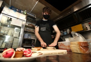 Chef Scott Cope prepares a sandwich at the Pudding Pantry in Nottingham which will be helping children in need during the school holidays