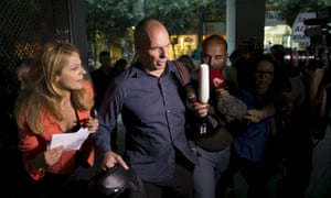 Yanis Varoufakis surrounded by the media as he leaves the finance ministry in Athens.