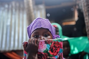 A Somali girl attends a class in a makeshift school at a refugee camp in Mogadishu.