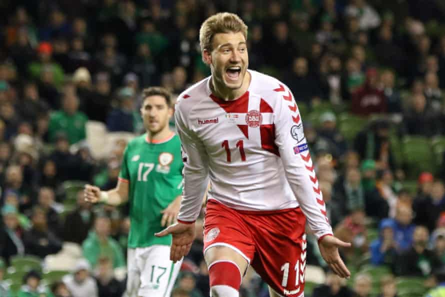 Bendtner celebrates after scoring Denmark's fifth goal in their World Cup play-off against the Republic of Ireland. The 5-1 victory sealed Denmark's place in the 2018 finals in Russia.