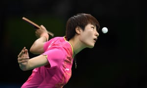 Ding Ning eyes the ball as she serves against Li Xiaoxia in their women's singles final.