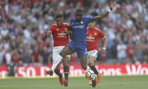 Antonio Valencia and Chelsea's Antonio Rudiger (centre) battle for the ball.