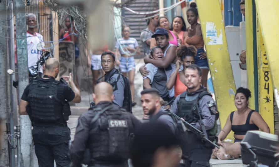 Police patrol the Jacarezinho favela