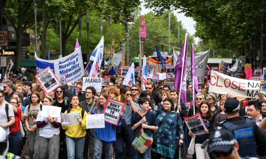 Demonstrators at rally supporting refugees in Melbourne on Saturday.