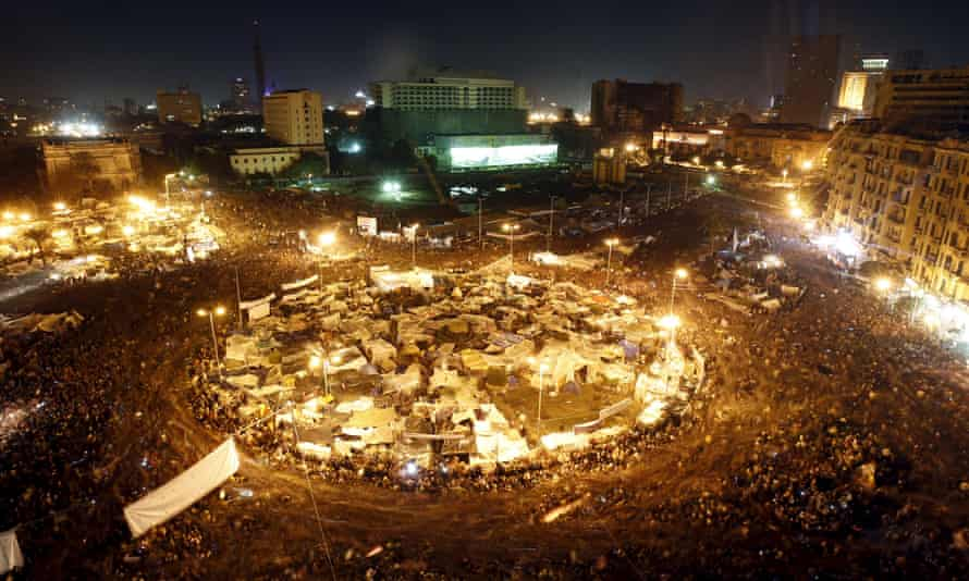 Cairo's Tahrir Square listens to President Hosni Mubarak address the nation on 10 February 2011. He resigned the following day.