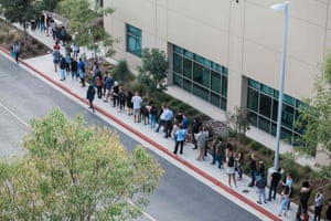 People wait in line to cast their ballot at a polling station on the San Diego Registrar's Office in San Diego, California.