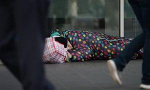 a man sleeps on the street