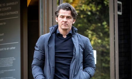 Joey Barton leaves Barnsley Magistrates Court, where he faced charges over allegedly attacking then Barnsley manager, Daniel Stendel, in April