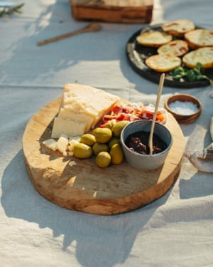 Cheese and olives on wooden board