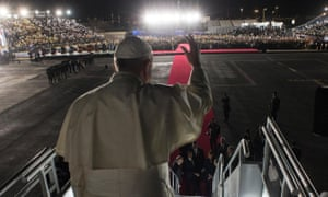 In this Wednesday, Feb. 17, 2016 photo, Pope Francis waves as he board his flight to Rome during the farewell ceremony at Ciudad Juarez, Mexico. (L'Osservatore Romano/Pool Photo via AP)