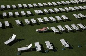 Minsk, BelarusA woman sunbathes in the open-air aquapark 'Dreamland'.