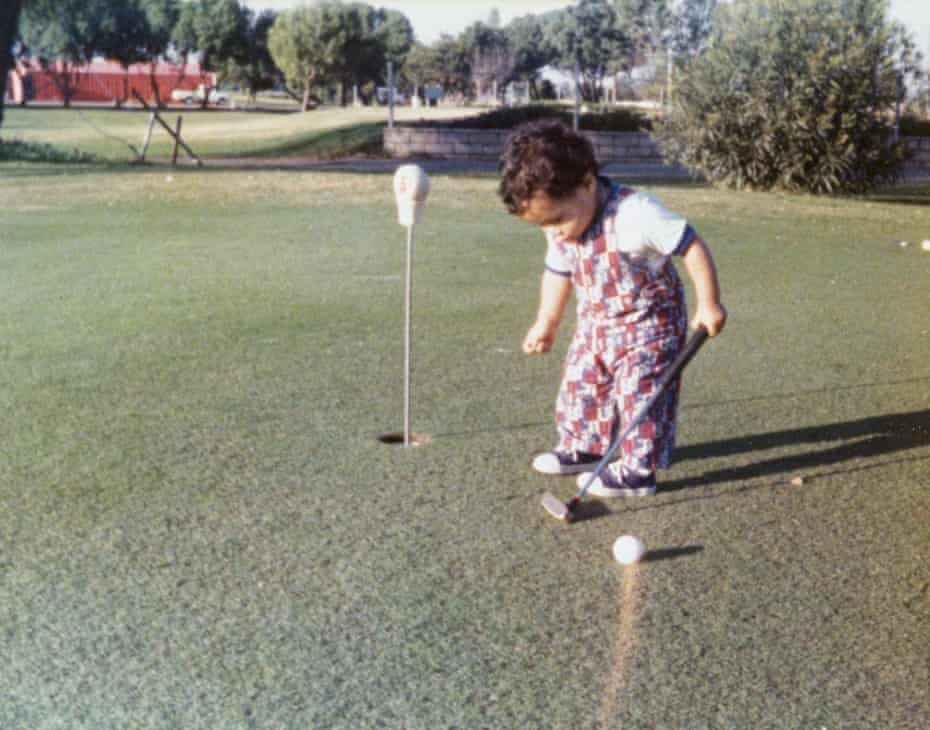 Tiger Woods practising his swing at 11 months old.