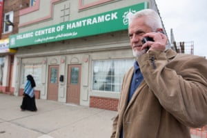 Arif Huskic makes a call in front of the Islamic Center of Hamtramck mosque.