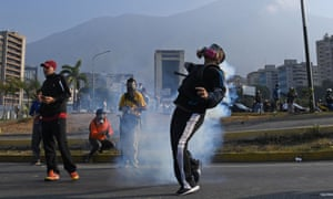 Protesters wear masks against tear gas.