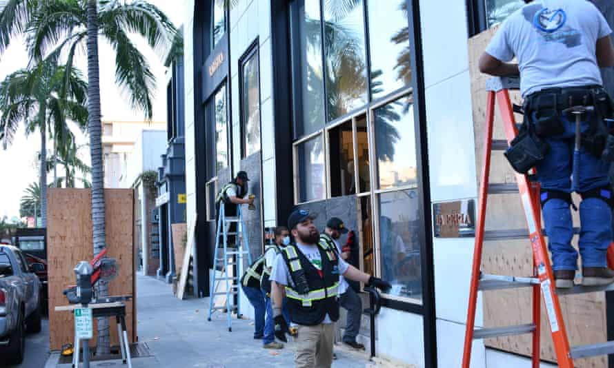 Workers board-up the La Perla store in anticipation of violence as a result of the upcoming election, in Beverly Hills.