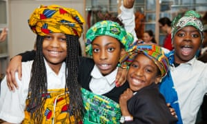 Children try on African head wraps.