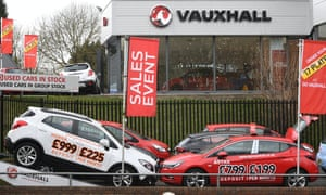 Cars on display at a Vauxhall dealership in London.