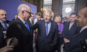 Boris Johnson (centre) speaking to Woody Johnson, the US ambassador to the UK, after Johnson's speech this morning in Greenwich.