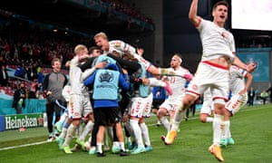 Denmark celebrate their third goal.