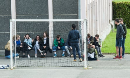 Students at Plouasne middle school in Brittany, France, which banned the use of mobile phone on its grounds four years ago.