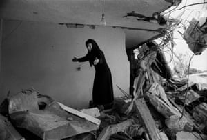 A Palestinian woman returning to the ruins of her house in Beirut in 1982.
