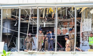 Officials inspect the damage at the Kingsbury Hotel after the attack.