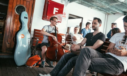 Jari Piper plays for passengers on an Istanbul ferry.