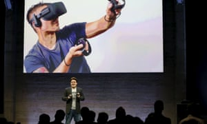 Oculus Founder Palmer Luckey displays an Oculus Touch input during an event in San Francisco, California June 11, 2015.