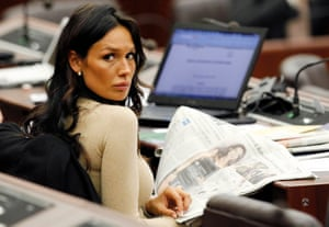January 2011: Nicole Minetti reads a newspaper during a meeting at the Lombardy regional headquarters in Milan. Minetti, formerly Berlusconi's dental hygienist, is alleged to have recruited young women to attend parties at the prime minister's residence. Minetti denies the claims