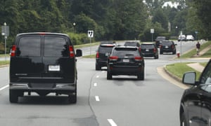 Trump's motorcade drives to Trump National Golf Club in Sterling, Virginia, on Saturday.