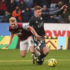 FBL-ENG-PR-BURNLEY-LEICESTERBurnley's defender Ben Mee (L) fouls Leicester City's midfielder Harvey Barnes (R) to concede a penalty.