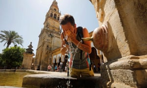 A tourist refreshes himself from a fountain at the Mosque-Cathedral of Córdoba in Spain.