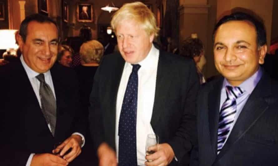 Boris Johnson pictured at the dinner with the 'London professor', Joseph Mifsud (left) and Prasenjit Kumar Singh.