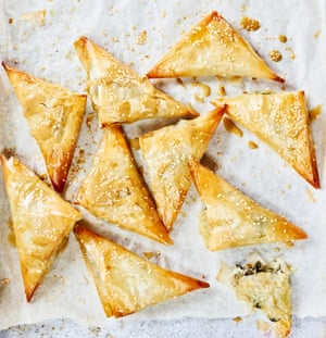 Anna Jones' börek pastries with feta, greens, sesame and dark molasses tahini.