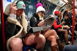 People take part in the annual 'No Trousers On The Tube Day' (No Pants Subway Ride) on the Central line in London