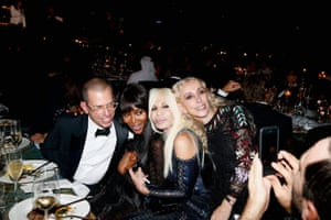 Sozzani with Jonathan Newhouse, Naomi Campbell and Donatella Versace in 2013.