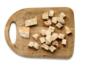 Chunks of bread on a chopping board