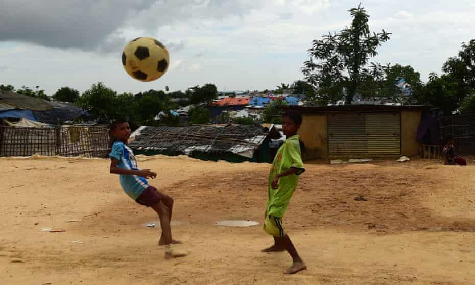 Rohingya refugee children play football at the Kutupalong refugee camp in Ukhia.
