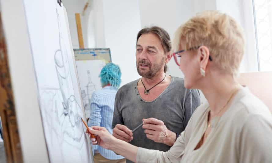 Artists sketching in art class studio.