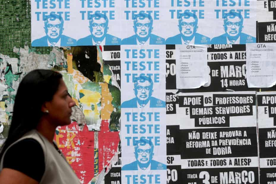 Posters of WHO chief Tedros Adhanom in Sao Paulo, Brazil last week.