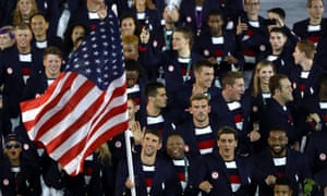 Olympic swimmer Michael Phelps leads the US Olympic team during the opening ceremony in Rio. Few athletes will reach his level of wealth and success.