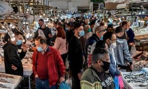 People, wearing face masks, shop at the Athens central market on November 5, 2020.