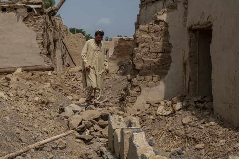 Badshah Dullah, 40, stands in what is left of his house in Khost, Afghanistan, hit 15 years ago - though Dullah has never been able to rebuild it.