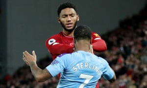 Liverpool's Joe Gomez clashes with Raheem Sterling during his team's victory over Manchester City on Sunday.