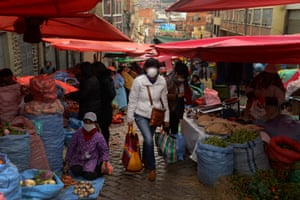 A woman shopping in a local market during the health emergency in La Paz, Bolivia, March 20.