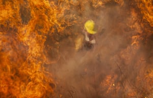 A firefighter battles flames in Capilla del Monte, Argentina